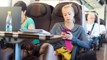 lady-train-smartphone-shutterstock