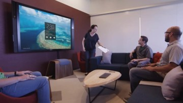 Surface Hub displaying its home screen in a meeting room