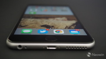 The iPhone 6s Plus lying face up on a table