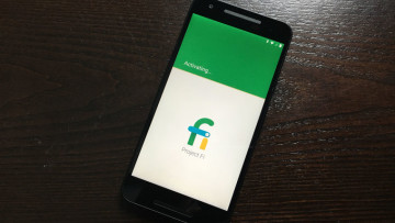 Phone activating Google Fi service on wooden background