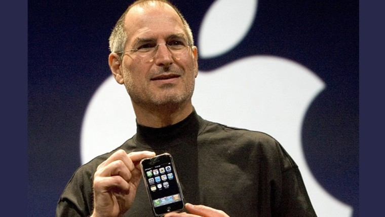 The late Steve Jobs presenting a new iPhone