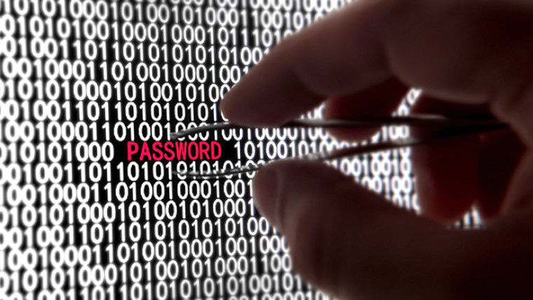 A hand picking a password from a collection of digits on the screen using tweezers