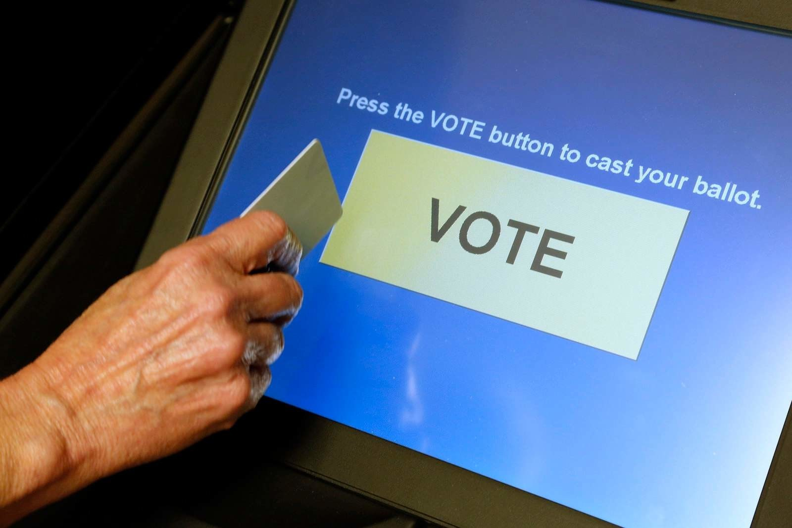 Virginia halts use of voting machines considered vulnerable to hacking