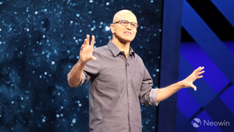 Satya Nadella explaining something in a conference