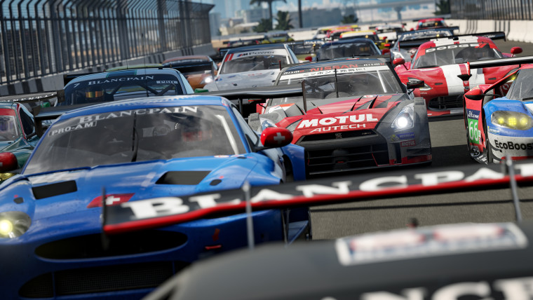 A bunch of cars racing on a track in Forza Motorsport 7