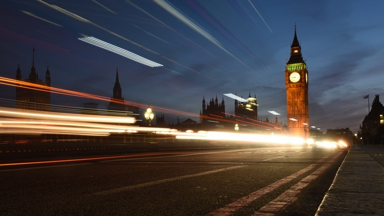 Vehicle light trails going across a bridge in front of Big Ben