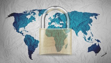 A world map with a padlock in the foreground