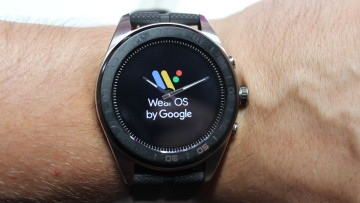 LG Watch W7 on a wrist with Wear OS by Google displayed on the screen