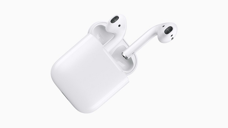 Apple AirPods popping out from their charging case
