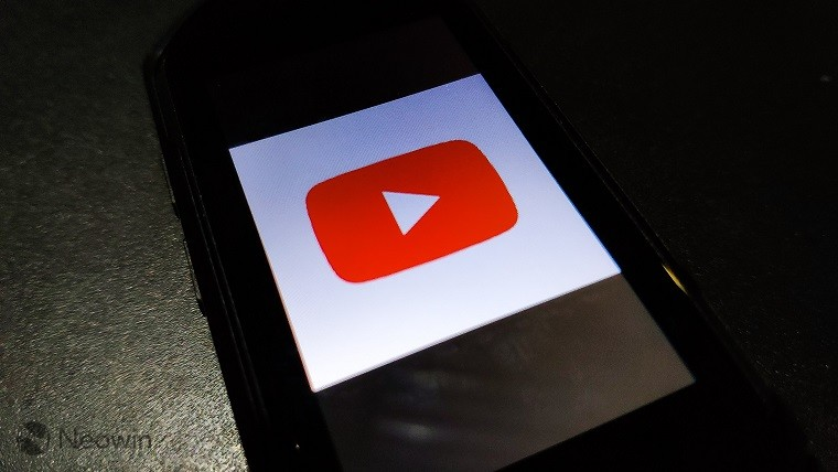 YouTube logo on a phone screen