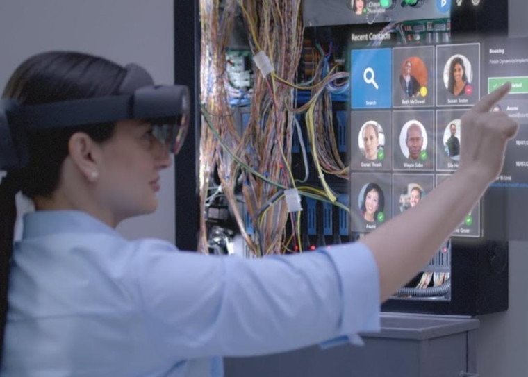 Woman using HoloLens 2 and interacting with UI