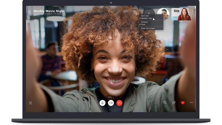 A screenshot of a Skype call running on a laptop