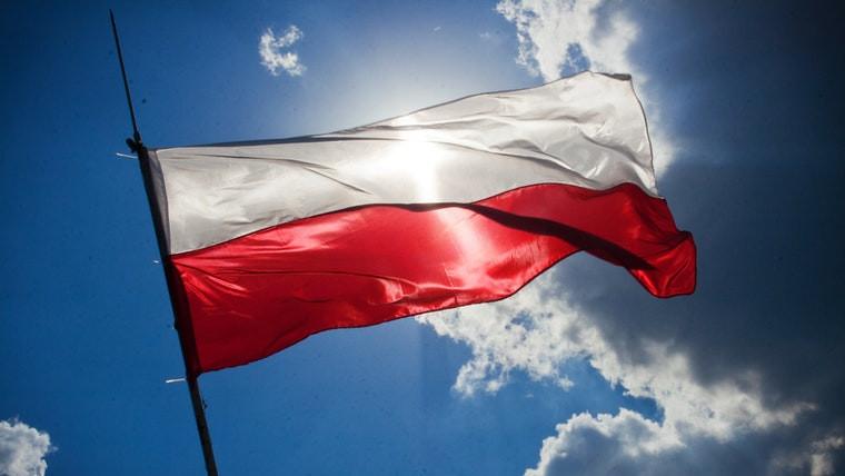 The Polish flag against a blue sky