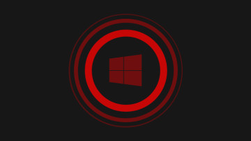 Windows 10 logo in red and surrounded by red circles on a dark background