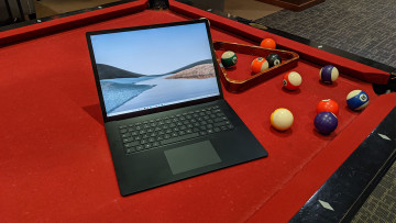 Surface Laptop 3 open on a pool table