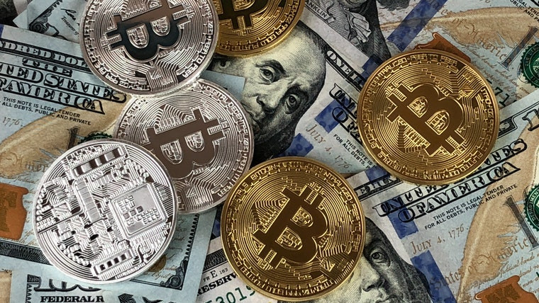 Stock image of Bitcoin and US Dollars