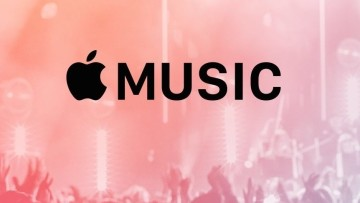 The Apple Music logo with a concert in the background