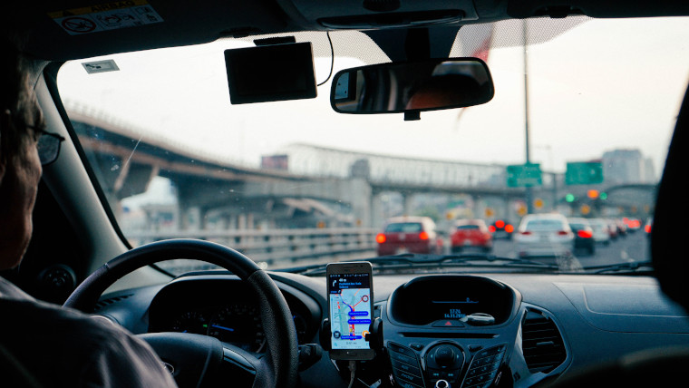 Inside an Uber cab from the rear seat