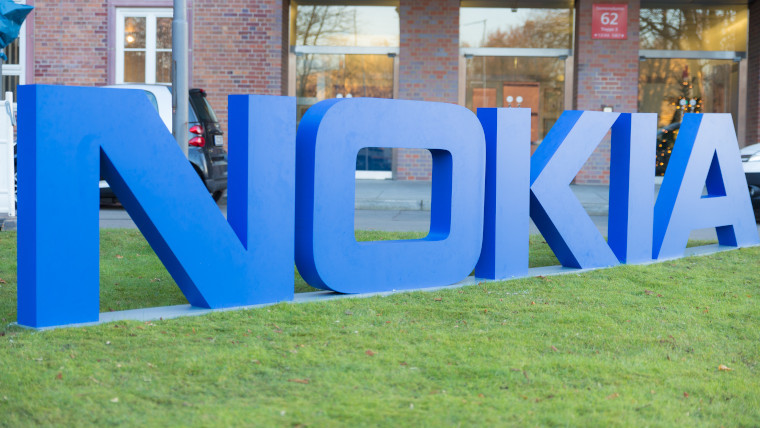 Nokia logo on grass outside of a building