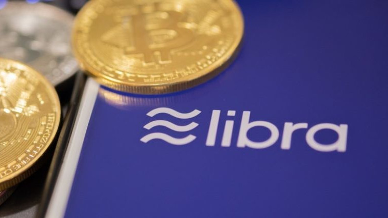 The word libra next to two physical bitcoins