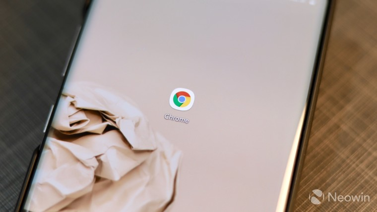 An icon for Google Chrome on the screen of a phone