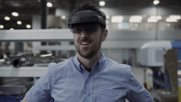 A man with HoloLens 2 on his head