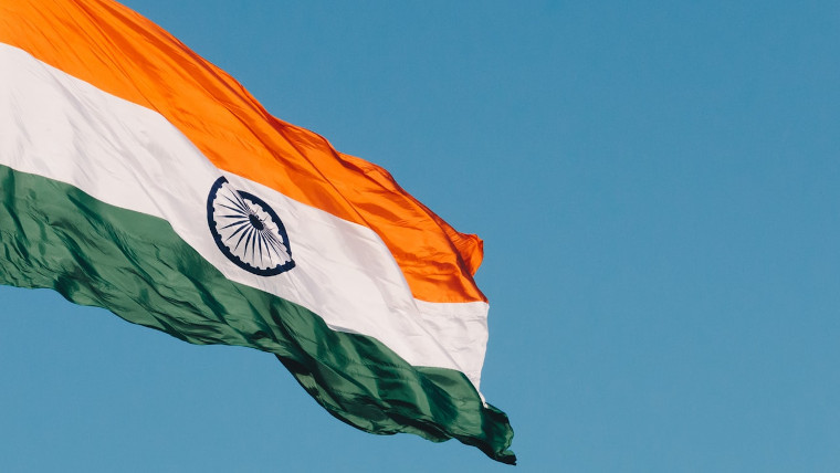 The Indian flag in front of a blue sky