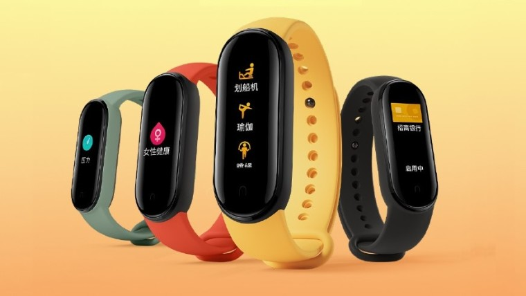 Xiaomi Mi Bands on an orange and yellow background