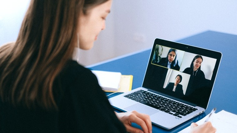 A woman on a video call on her laptop
