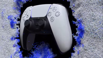 A Dualsense controller on a white and black background