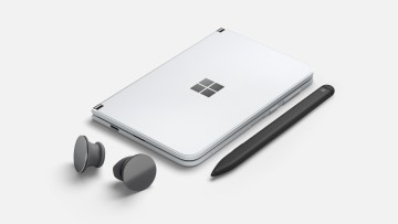 Surface Duo, closed, with Slim Pen and Surface Earbuds