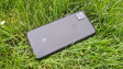 The back of the Google Pixel 4a with the phone placed on grass