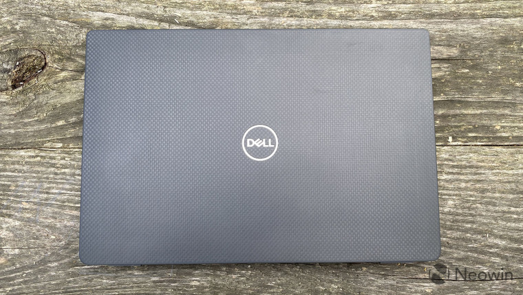 Dell Latitude 7320 top-down view with wood background