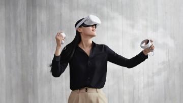 A woman using an Oculus Quest 2 headset