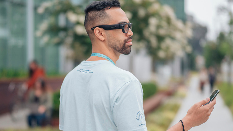 A man wearing Project Aria glasses