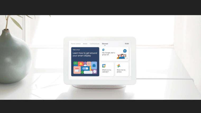 A first generation Google Nest Hub displaying the Discover tab