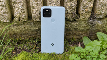 Google Pixel 5 standing vertically against a stone wall