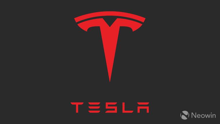 The Tesla logo on a dark grey background