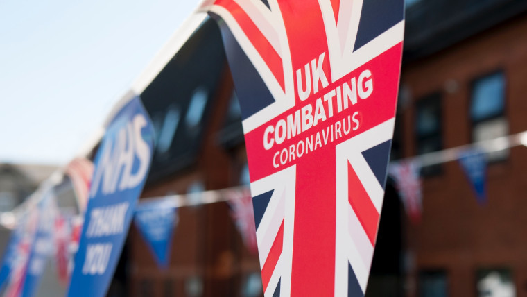 Union Jack that reads 'UK combating coronavirus'