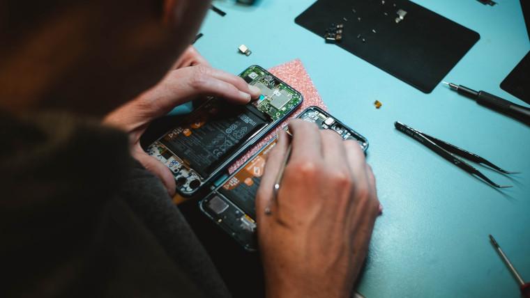 Someone repairing a smartphone