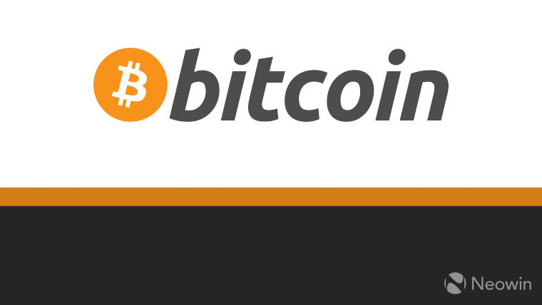 The bitcoin logo on a white gold and black background