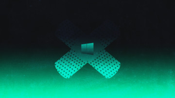 A Windows logo against a band aid over a green and black background