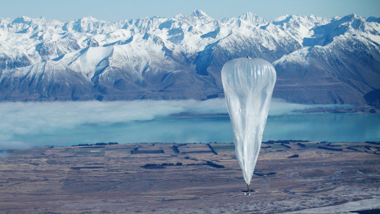 A Loon balloon with mountains in the background