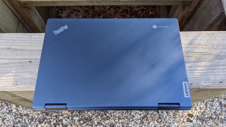 Lenovo ThinkPad C13 Yoga in blue, on top of wood