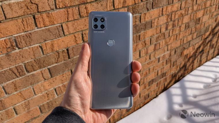 Back of Motorola One 5G Ace with brick background