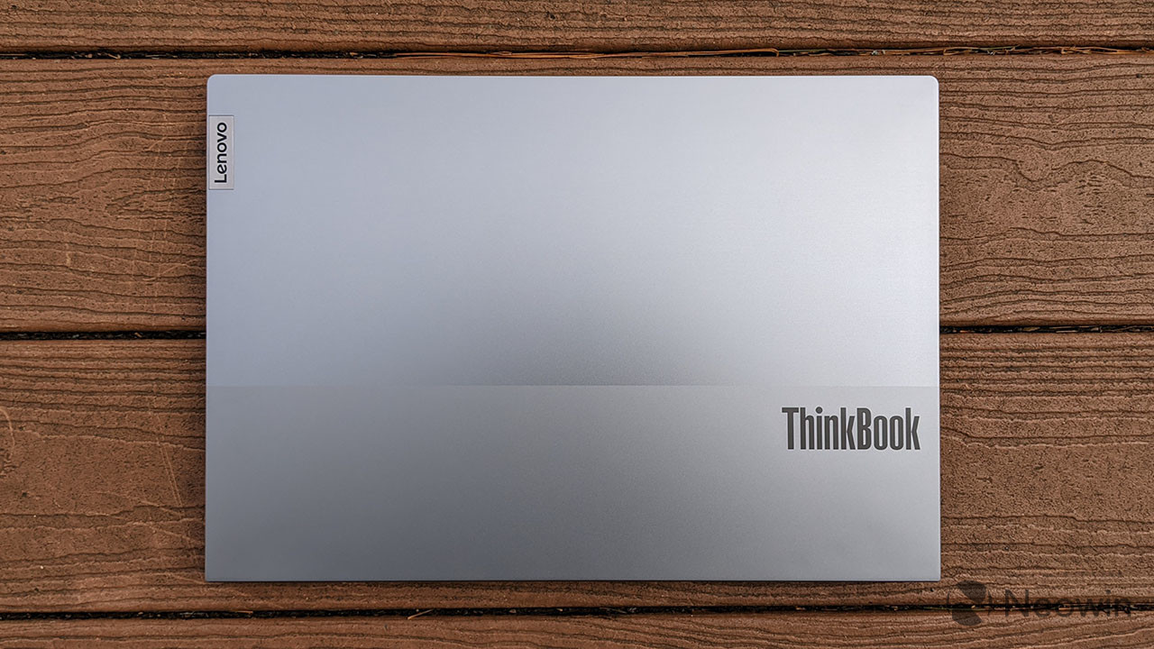 Lenovo ThinkBook 15p with closed lid on wooden background