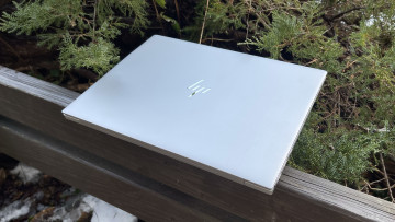 Silver HP Envy 14 closed on wooden gazebo