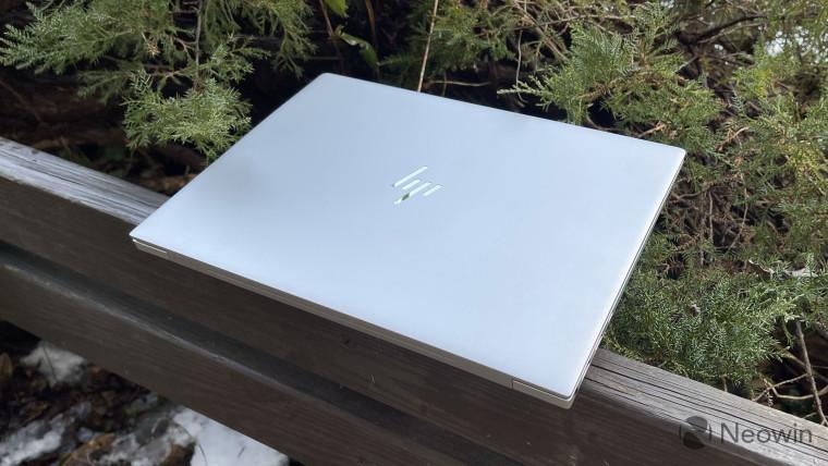 Silver HP Envy 14 closed on wooden gazebo