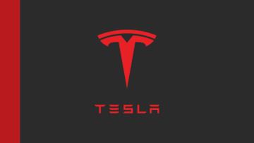 The Tesla logo on a black background