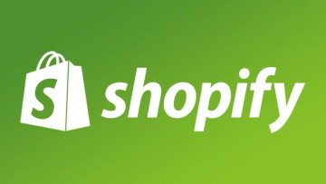 groceries bag labeled with a large S and the word Shopify next to it